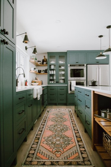 farmhouse style kitchen with green cabinets