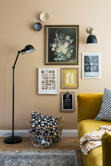 yellow living room with yellow gallery wall