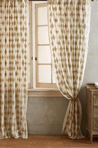 diamond pattern curtain near open window
