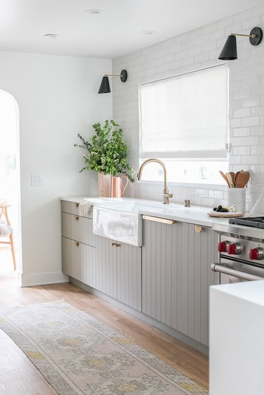 White rustic kitchen with subway tile backsplash and farmhouse sink
