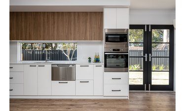 white melamine kitchen cabinets with stainless steel appliances