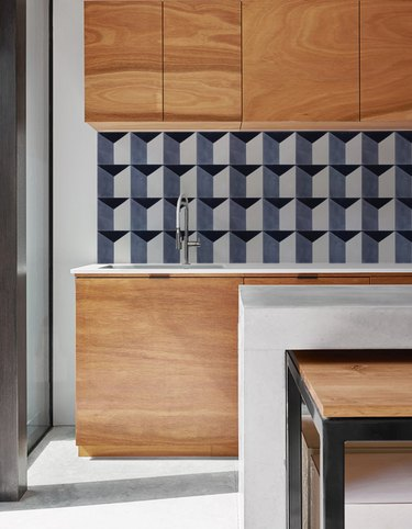 geometric pattern wallpaper backsplash in modern kitchen