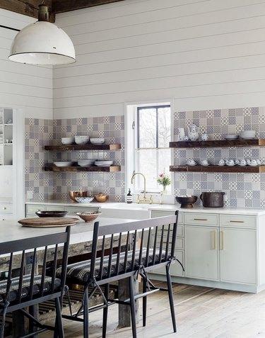 blue pattern tile backsplash in kitchen mint green cabinets and shiplap walls