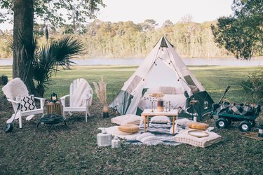 backyard glampover with tent and chairs