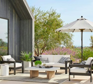 Sitting area outside with unbrella and couches