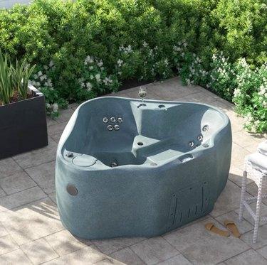 wayfair Portable Hot Tub in bricked yard