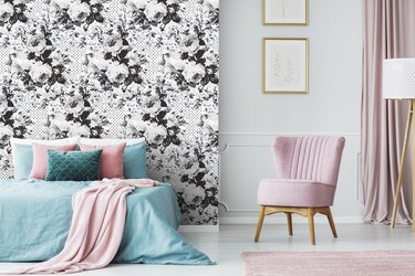 bedroom with black-and-white floral wallpaper