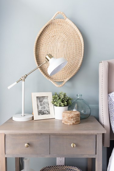 Coastal paint colors in bedroom with hanging basket on blue gray wall