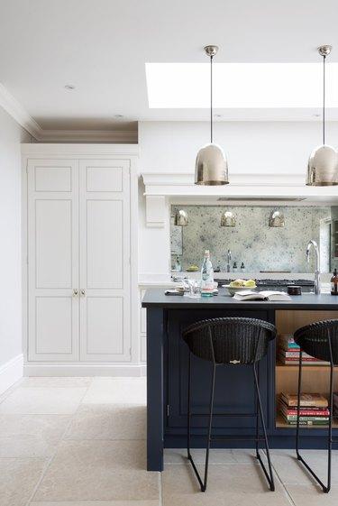mirror kitchen backsplash idea with white cabinets and blue island