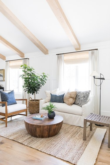 white coastal farmhouse living room with wood coffee table