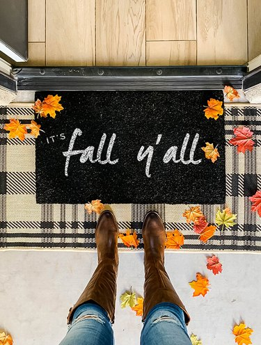 It's Fall Y'all fall doormat in black and white with plaid rug
