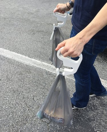 Carrying groceries with sanitary shopping cart handles