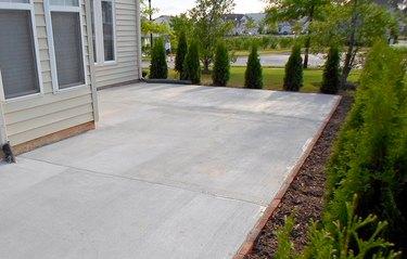 Clean, resurfaced concrete patio.