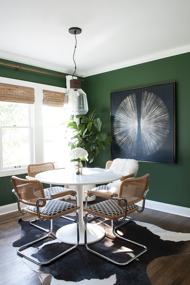 small dining room with artwork on wall