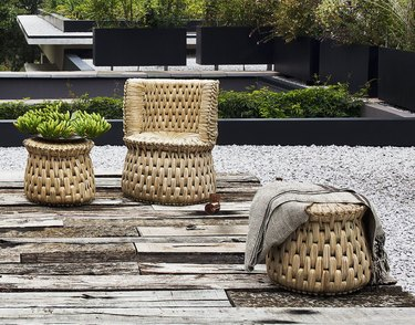 woven lounge chair and side table outdoors