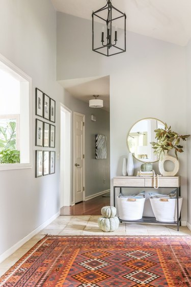 light green fall pumpkins in entryway with patterened rug