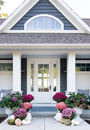 craftsman house with fall porch decor