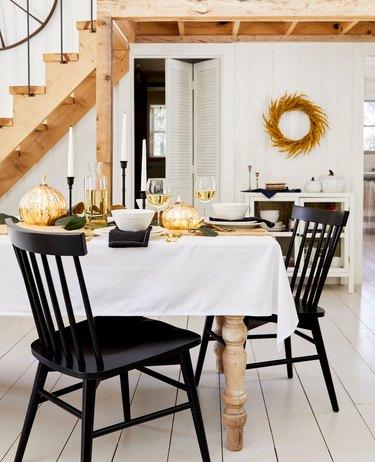 metallic fall pumpkins on table in Scandi dining room
