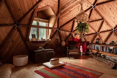 rustic attic idea with wood ceiling and floors