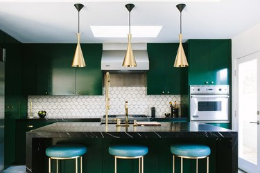 midcentury kitchen with geometric tile backsplash