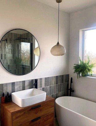 midcentury modern diy bathroom backsplash idea with vertically applied subway tile