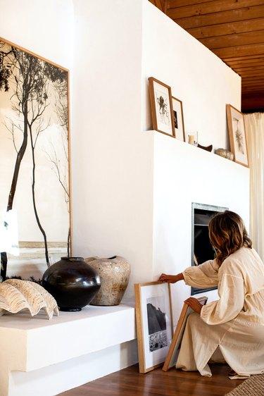 Kara Rosenlund living room art near fireplace