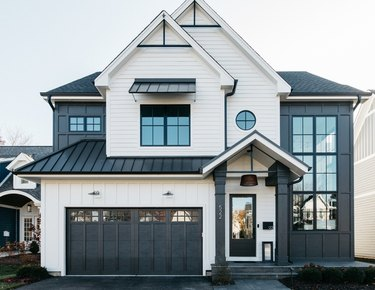 exterior modern farmhouse with oversize windows and black and white palette
