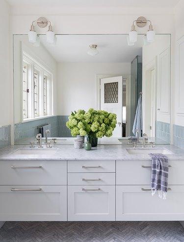 diy bathroom backsplash idea in classic bathroom with oversize traditional mirror