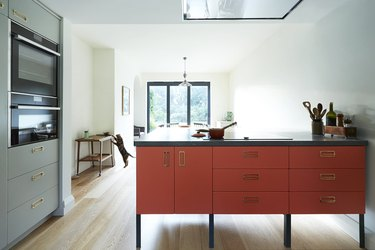 kitchen color idea with orange island and blue cabinets
