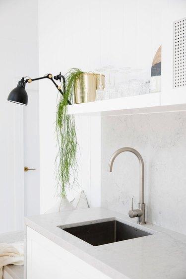 Integrated sink in minimalist kitchen