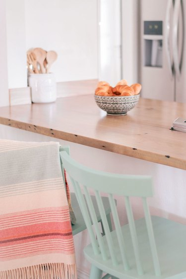 Reclaimed wood kitchen countertop with pastel accents