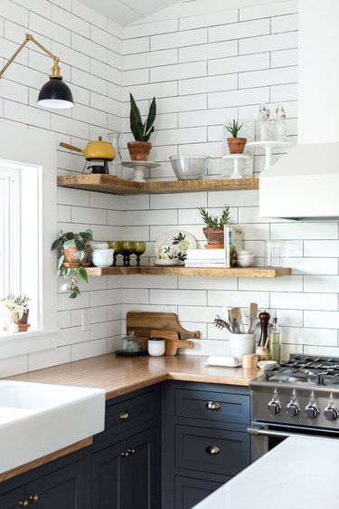 Wood kitchen countertop with blue cabinets