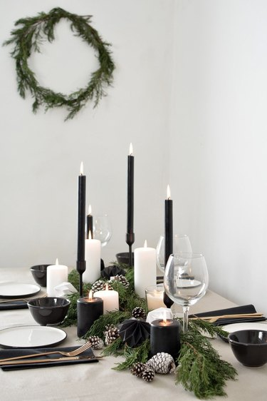 white and black tablescape with black candles for Christmas centerpiece