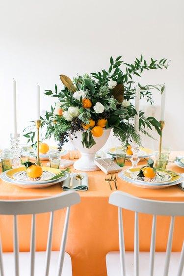 orange table with citrus arrangement for Christmas centerpiece