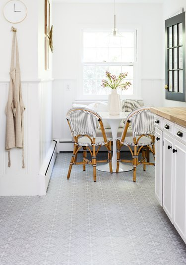 peel and stick kitchen vinyl flooring with white cabinets and wood countertop