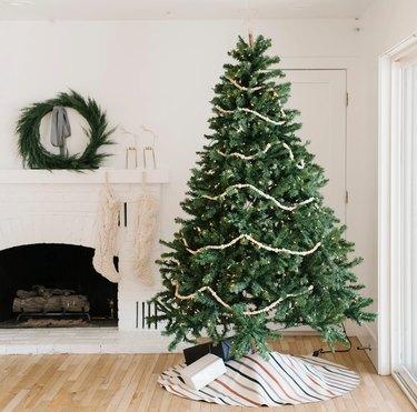 farmhouse Christmas decor with tree skirt in white farmhouse living room