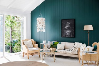 living room with teal green painted wall