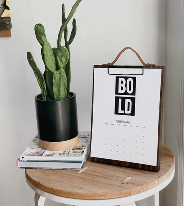 small table with plant and clipboard