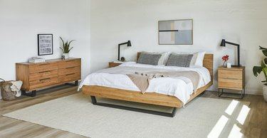 bauhaus furniture in bedroom with wood bed and wood dresser