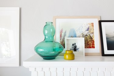 Objects and art on the mantel.