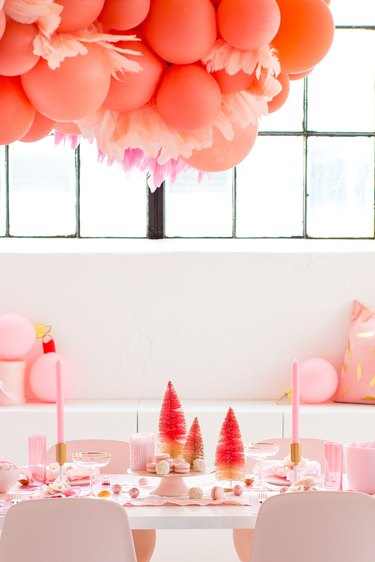 pink dining room with balloons and bottlebrush trees for Christmas centerpiece