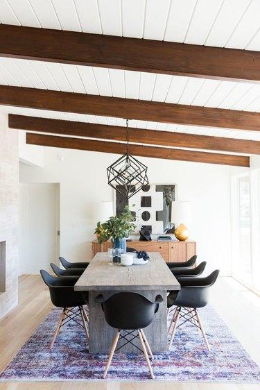Midcentury dining room idea with modern black light fixture
