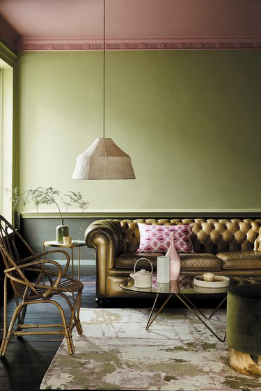 green colorblocked living room with painted ceiling