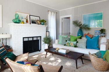 Pops of color in the living room with hand me down sofa.