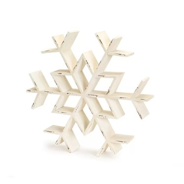 farmhouse Christmas decor with snowflake wall shelf with chipped paint in white