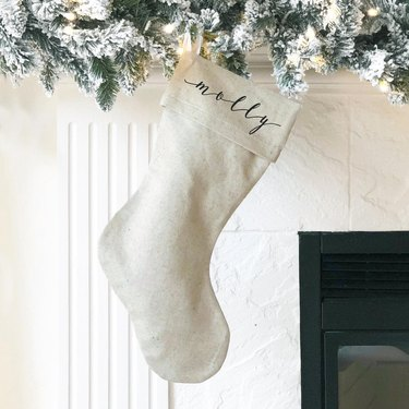 Customized farmhouse Christmas decor with stocking in burlap with script lettering