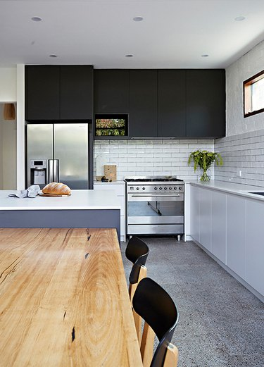 black and white kitchen with black upper cabinetry