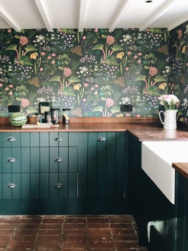 green farmhouse kitchen with statement floral wallpaper