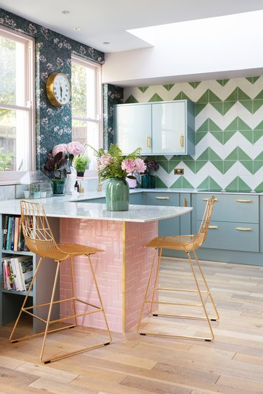 maximal kitchen with tile and wallpaper accent walls