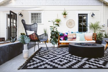 The outdoor room with fire pit and places to sit.